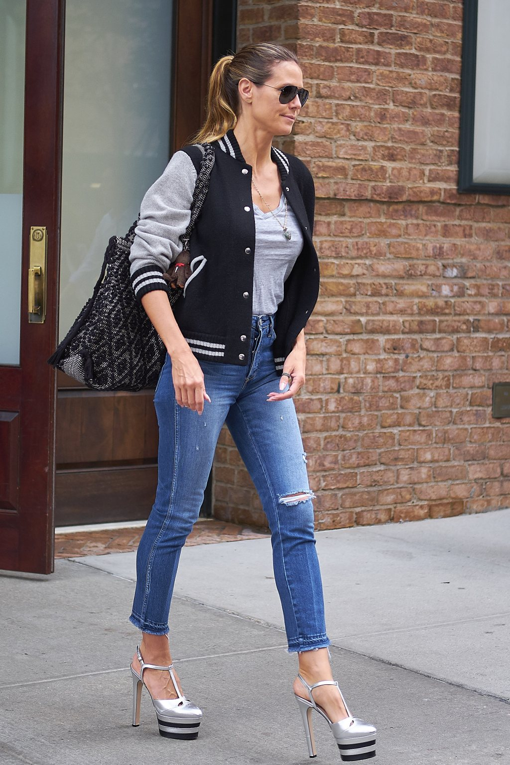 Heidi Klum seen wearing a varsity jacket and heels while out and about in NYC
